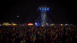 Crowd of people clapping at rock concert during night Footage