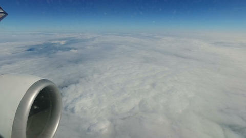 Airplane flight above clouds - window view Footage