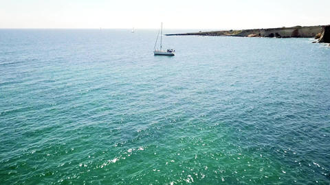 Aerial view of sailboat on blue sea ビデオ