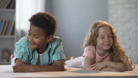Cute little children clumsily flirting with each other, first childhood love Footage