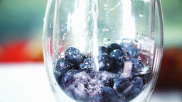 Slowmotion berries in a glass with water 3 ビデオ