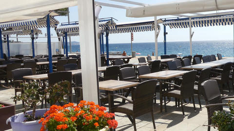 Empty Restaurant By The Sea Outdoor Tables GIF
