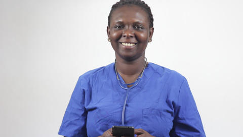 portrait of young woman with mobile phone, smiling Footage