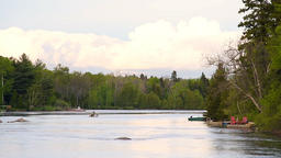 Chicoutimi river in Saguenay, Quebec, Canada with riverfront houses ビデオ