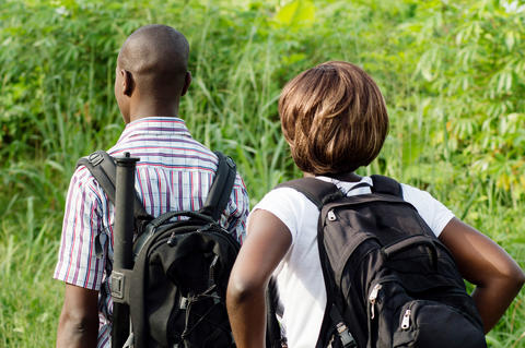 young couple walking in the bush Photo