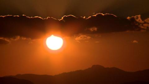 Sunset behind hills Footage