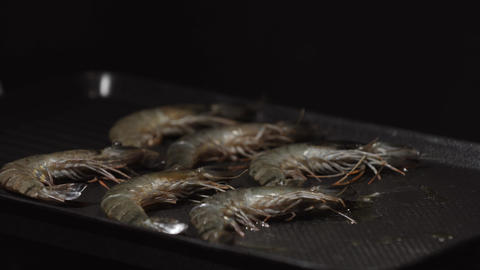 Grilling and fried shrimps on electric barbecue. Healthy Grilled seafood on bbq Live Action