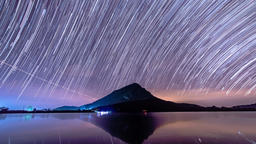 Star Trails moving on mountain and lake in the night 영상물