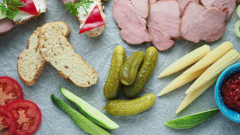 Cold appetizer. Cold cuts. Different snacks on a white crumpled paper, from Live Action
