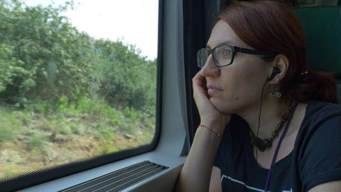 Girl with Eyeglasses Travelling by Train Footage