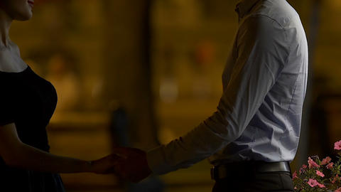Attractive man and woman kissing in street of night city, intimate relationship Footage