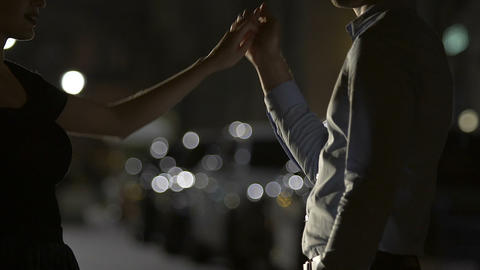 Attractive couple dancing in night street, romantic date, love relationship Live Action