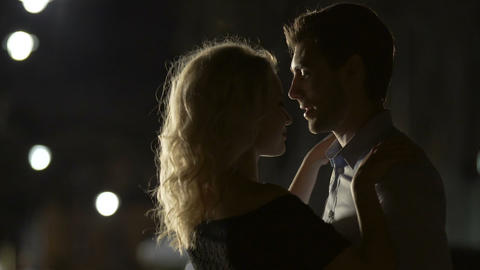 Young male and female dancing in street at night, beginning of relationship Live Action