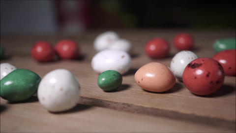 Colorful candies on wooden table surface, backdrop Live Action