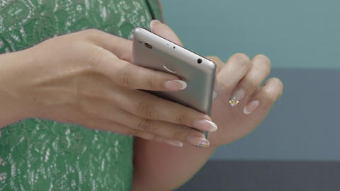 Close Up View On Hands Of Employees Watching Video On Smartphone Indoors Footage