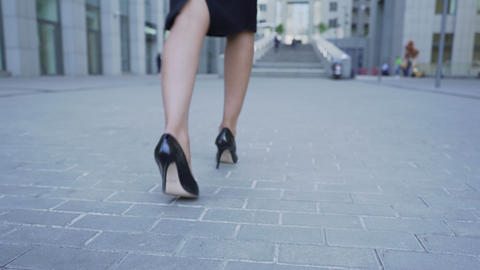 Businesswoman holding laptop in hand walking to stairs of business center career Footage