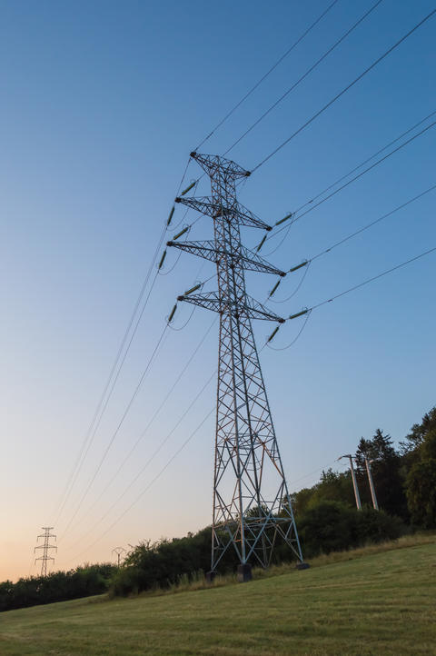 High voltage pylon at sunrise in the Gaume フォト
