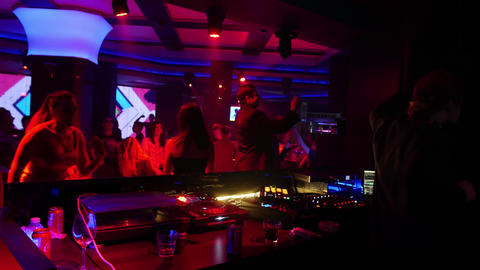 Dj and crowd dancing in a night club - live dj performance mix Live Action