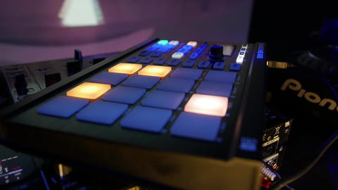 MIDI controller during dj live performance in a night club - electronic music Live Action