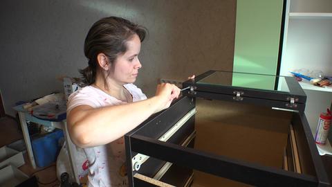 Girl repairing furniture. 4K Live Action
