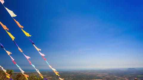 Garlands of Colourful Flags against Sea Blue Sky Footage
