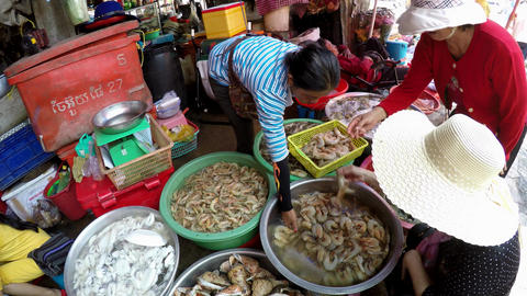 Three Cambodian Women Selecting Fresh Prawns for Dinner Footage