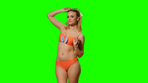 Girl dancing in a swimsuit on the green alpha Footage