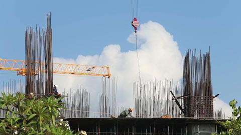 View Of Operating Crane Engine Pulling Hook Against Clouds stock footage