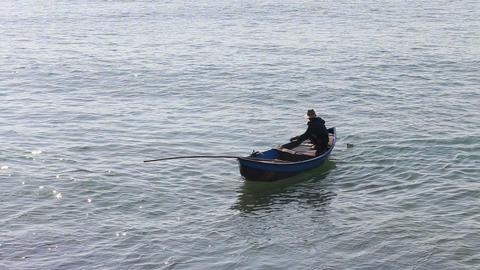 vietnamese fisherman pulls net out of water Footage