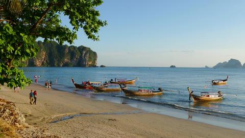 Long Tail Boats And Tourists On Ao Nang Beach stock footage