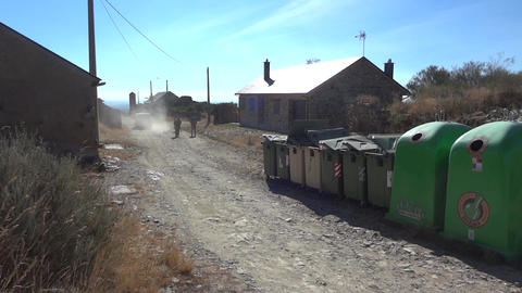 Car that raise clouds of dust when passing near the garbage and pilgrims crossin Footage