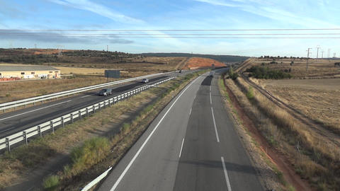 Cars and freight cars moving on a highway 02 Footage