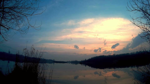 Sunset on the lake that reflects the sun Footage