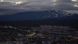 Summer nighttime Petropavlovsk Kamchatsky City on background of volcano GIF