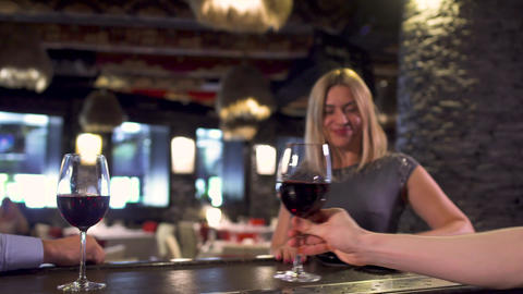Man orders wine for beautiful lady in restaurant Footage
