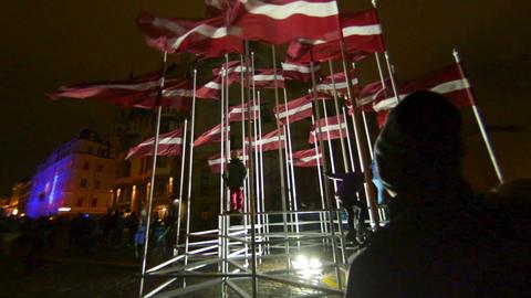 Many Flags of Latvia on 18 of November day celebration light festival Staro Riga 영상물