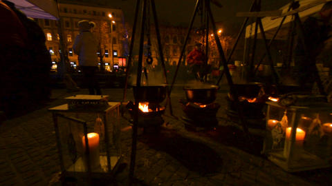 Huge cauldrons preparing food on fire on the street food fire festival in Riga Live Action