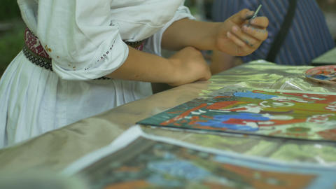 Boy Painting Religious Icon on Glass Footage
