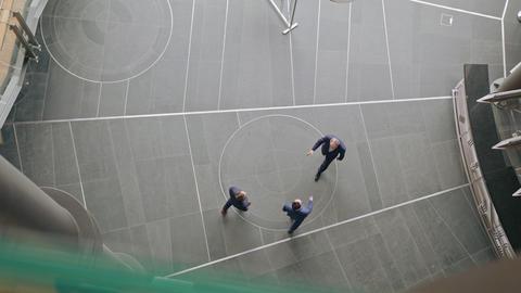 Three Business People Handshaking. Topview 영상물