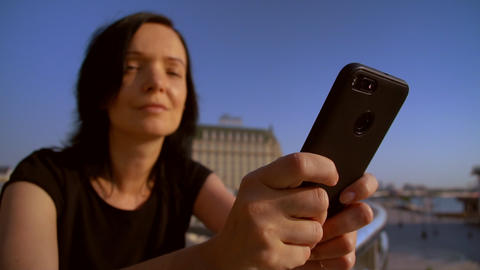 close-up of a woman using her mobile phone ビデオ