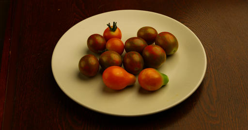Tomatoes on a plate Live Action