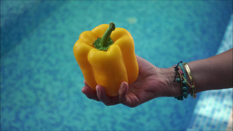 Yellow bell pepper in woman s hand Footage