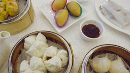 Smooth panning video of Chinese Yum cha with Dim Sum and tea Footage