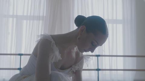 Ballerina dancing in studio GIF
