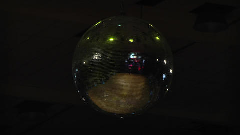 Silver disco ball that rotates and that reflects the multicolored lights strobe Footage