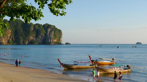 Long tail boats and tourists on Ao Nang beach Footage
