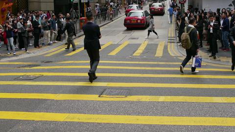 People crossing the street at a crosswalk. Time Lapse. Seamless Loop Footage
