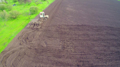 Aerial of Old Tractor on Harvest Field Footage