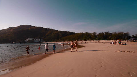 wide angle - low tide people walking at beach Live Action