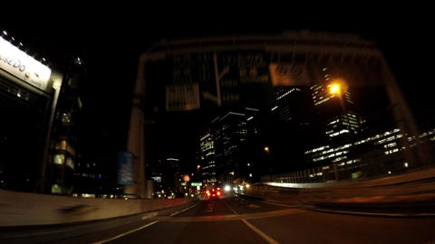 Japanese cityscape, Tokyo,. Night capital highway running a wheeled vehicle ビデオ